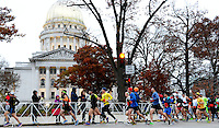 Runners start the full marathon during the 2014 Madison Marathon on Sunday, November 9, 2014, in Madison, Wisconsin