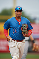 Clearwater Threshers right fielder Jhailyn Ortiz (26) jogs to the dugout during a Florida State League game against the Lakeland Flying Tigers on May 14, 2019 at Spectrum Field in Clearwater, Florida.  Clearwater defeated Lakeland 6-3.  (Mike Janes/Four Seam Images)