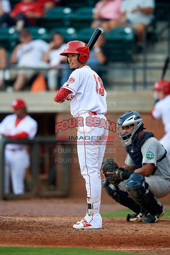 Greeneville Reds shortstop Miguel Hernandez (33) at bat in front of catcher Carlos Narvaez (48) during a game against the Pulaski Yankees on July 27, 2018 at Pioneer Park in Tusculum, Tennessee.  Greeneville defeated Pulaski 3-2.  (Mike Janes/Four Seam Images)