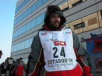 Jon Little.Lance Mackey gets his team ready to leave from downtown Anchorage in the March 4, 2006, ceremonial start.