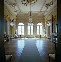 A neoclassical ballroom contained in one of two long wings of the re-fashioned pavilion at Haga has an ornate plasterwork ceiling