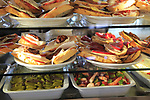 Tapas food display inside famous historic Los Gatos Cervecerias bar, Madrid city centre, Spain