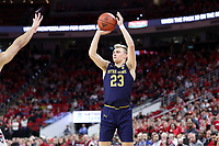 RALEIGH, NC - JANUARY 9: Dane Goodwin #23 of the University of Notre Dame takes a shot during a game between Notre Dame and NC State at PNC Arena on January 9, 2020 in Raleigh, North Carolina.