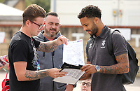 Lincoln City's Bruno Andrade signs autographs for waiting fans as he arrives ahead of kick-off at SIncil Bank<br /> <br /> Photographer Rich Linley/CameraSport<br /> <br /> The EFL Sky Bet League One - Lincoln City v Bristol Rovers - Saturday September 14th 2019 - Sincil Bank - Lincoln<br /> <br /> World Copyright © 2019 CameraSport. All rights reserved. 43 Linden Ave. Countesthorpe. Leicester. England. LE8 5PG - Tel: +44 (0) 116 277 4147 - admin@camerasport.com - www.camerasport.com