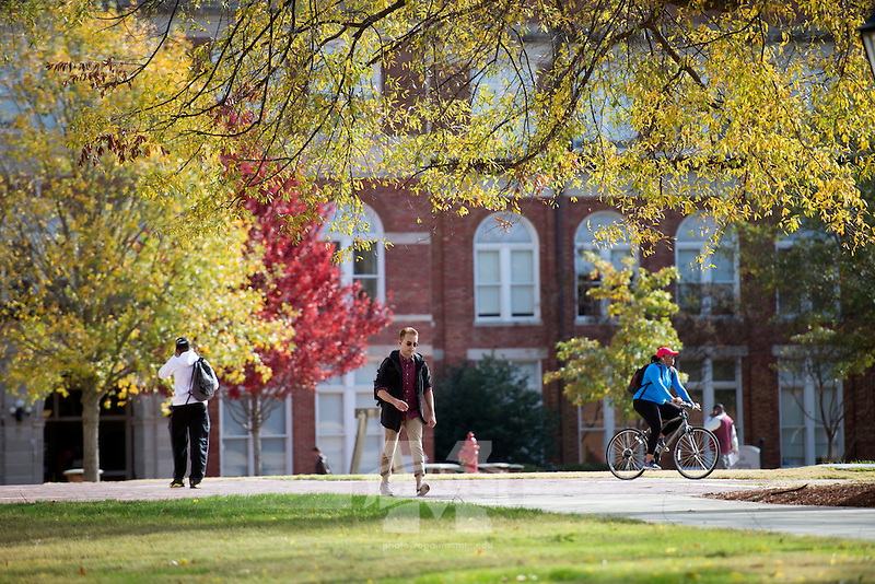 Drill Field fall leaves with pedestrians.<br />   (photo by Megan Bean / &copy; Mississippi State University)