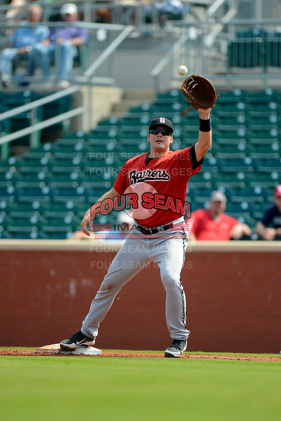 Birmingham Barons first baseman Dan Black #22 takes a throw during a game against the Chattanooga Lookouts on April 17, 2013 at AT&T Field in Chattanooga, Tennessee.  Chattanooga defeated Birmingham 5-4.  (Mike Janes/Four Seam Images)