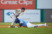 Danville Braves shortstop Beau Philip (4) applies a tag to Vinnie Pasquantino (33) of the Burlington Royals as he slides into second base at Burlington Athletic Stadium on August 9, 2019 in Burlington, North Carolina. The Royals defeated the Braves 6-0. (Brian Westerholt/Four Seam Images)