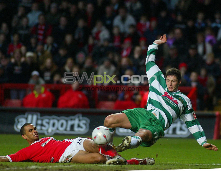 Pix: Danny Martindale/SWpix.com. FA Cup Forth Round. Charlton v Yeovil..29.01.2005...COPYRIGHT PICTURE>>SIMON WILKINSON>>01943 608782>>..Jonathan Fortune (Charlton) and Phil Jevons in action