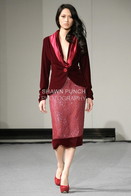 Elizabeth Thuytien walks runway in an outfit by Nedret Taciroglu, during Couture Fashion Week New York Fall 2012.