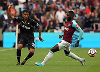 (L-R) Kyle Naughton of Swansea City passes the ball past Arthur Masuaku of West Ham during the Premier League match between West Ham United v Swansea City at the London Stadium, London, England, UK. Saturday 30 September 2017