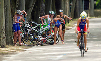 05 JUN 2010 - MADRID, ESP - Female competitors attempt to untangle their bikes after a crash at the Madrid round of the womens ITU World Championship Series triathlon .(PHOTO (C) NIGEL FARROW)