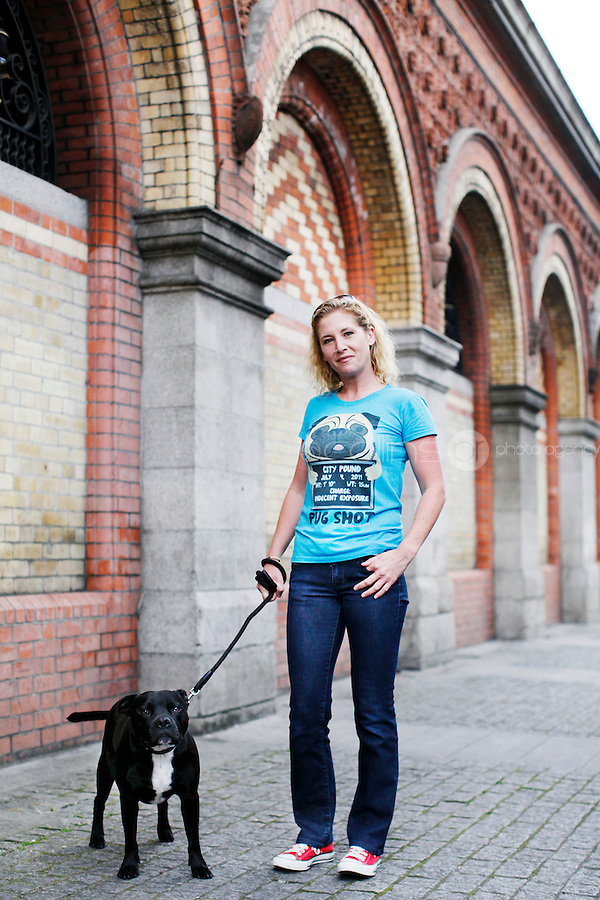 26/8/2011. Dublin Fruit and Vegetable Market. Liane Butler and her dog Jay from Matt Buttler Wholesellers is pictured at the Dublin Fruit and Vegetable Market. Picture James Horan/Collins Photos