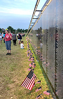 Sally Carroll/McDonald County Press<br /> People of all ages view The Wall That Heals, a traveling exhibit that resembles the Vietnam Veterans Memorial in Washington, D.C. Downtown Bentonville hosted the exhibit over Memorial Day weekend. A mobile education center featured a video highlighting area veterans, including those from McDonald County.