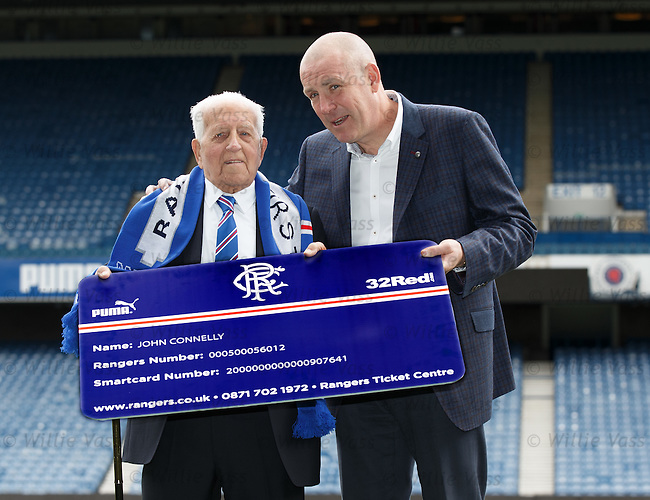 100 year old Rangers fan John Connelly with Rangers manager Mark Warburton as he gets a free season ticket for the forthcoming season