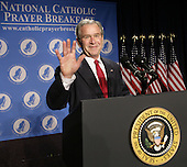 United States President George W. Bush waves before making remarks at the National Catholic Prayer Breakfast in Washington, D.C. on April 18, 2008.<br /> Credit: Yuri Gripas / Pool via CNP