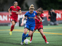 Seattle, WA - Saturday, May 14, 2016: Sky Blue FC defender Erica Skroski (8) and Portland Thorns FC midfielder Meleana Shim (6). The Portland Thorns FC and the Seattle Reign FC played to a 1-1 tie during a regular season National Women's Soccer League (NWSL) match at Memorial Stadium.
