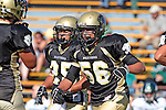 Palos Verdes, CA 10/08/10 - Walt Proenca (Peninsula #56) and Logan Okuda (Peninsula #25) in action during the South Torrance Spartans vs Peninsula Panthers Varsity football game at Palos Verdes Peninsula High School.