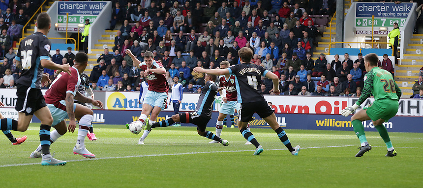 Burnley's Michael Keane shoots wide in a crowded penalty area<br /> <br /> Photographer Stephen White/CameraSport<br /> <br /> Football - The Football League Sky Bet Championship - Burnley v Sheffield Wednesday - Saturday 12th September 2015 -  Turf Moor - Burnley<br /> <br /> &copy; CameraSport - 43 Linden Ave. Countesthorpe. Leicester. England. LE8 5PG - Tel: +44 (0) 116 277 4147 - admin@camerasport.com - www.camerasport.com