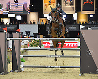 Steve Guerdat (Switzerland), riding Concetto Son at the Gucci Gold Cup International Jumping competition at the 2015 Longines Masters Los Angeles at the L.A. Convention Centre.<br /> October 3, 2015  Los Angeles, CA<br /> Picture: Paul Smith / Featureflash