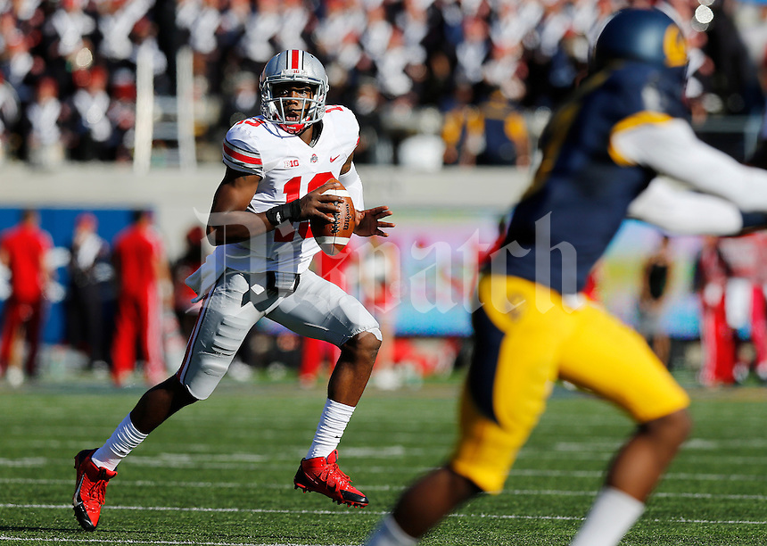 Ohio State Buckeyes quarterback Kenny Guiton (13) scrambles out of the pocket during the first quarter of the NCAA football game against California at Memorial Stadium in Berkeley, California on Sept. 14, 2013. (Adam Cairns / The Columbus Dispatch)