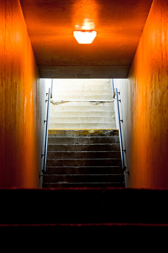 A set of stairs leading upwards to a source of bright light that suggests a new dimension.