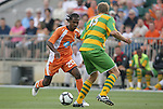 14 May 2010: Carolina's Gregory Richardson (GUY) (20) is defended by Tampa Bay's Joe Donoho (15). The FC Tampa Bay Rowdies defeated the Carolina RailHawks 2-1 at WakeMed Stadium in Cary, North Carolina in a regular season U.S. Soccer Division-2 soccer game.