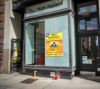 "A ""Now Hiring "" sign in the window of a Spirit Halloween pop-up store in New York on Saturday, September 3, 2016. Landlords who used to resist short-term leases are embracing the concept of pop-ups to get income from empty retail property. (© Richard B. Levine)"