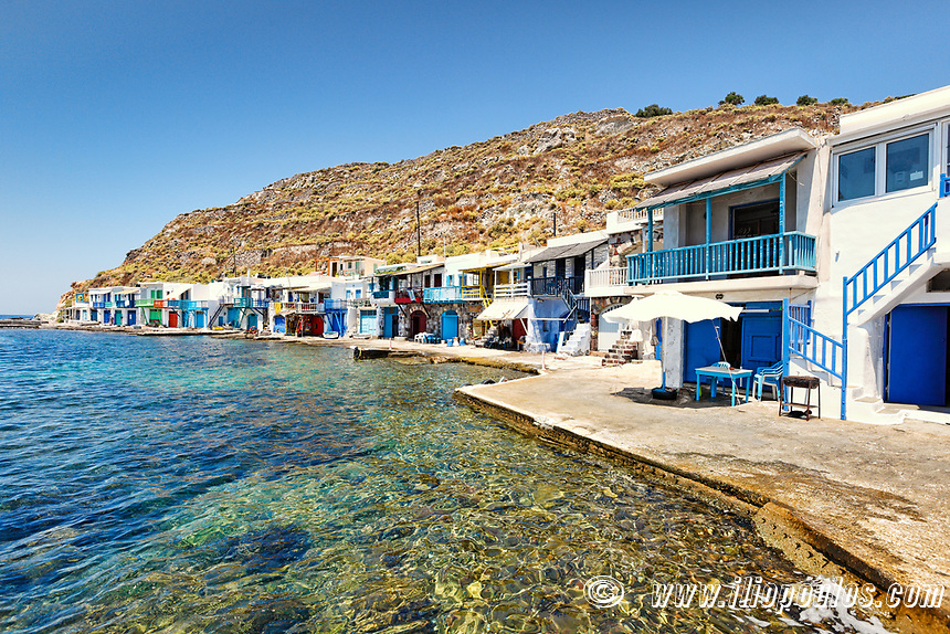 """Traditional fishermen houses with the impressive boat shelters, also known as """"syrmata"""" in Klima of Milos, Greece"""