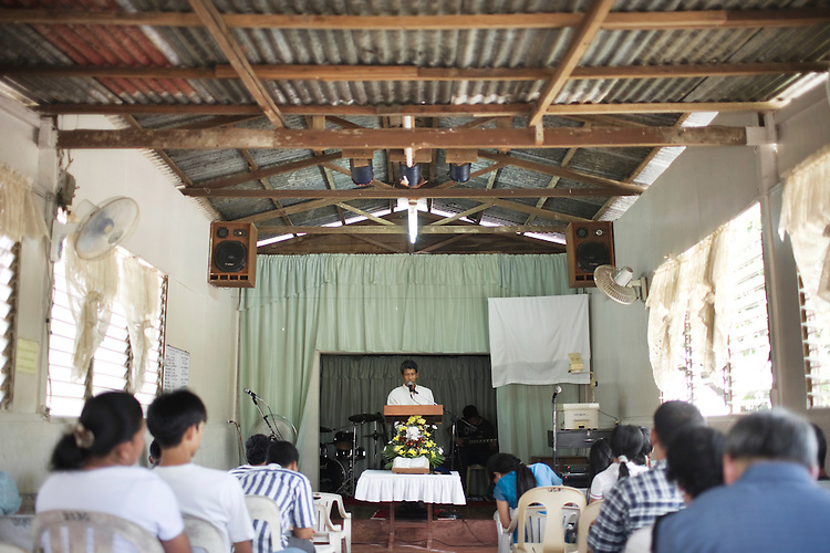 A pastor preaches at a small Christian church in a squatter village in Manila, Philippines.