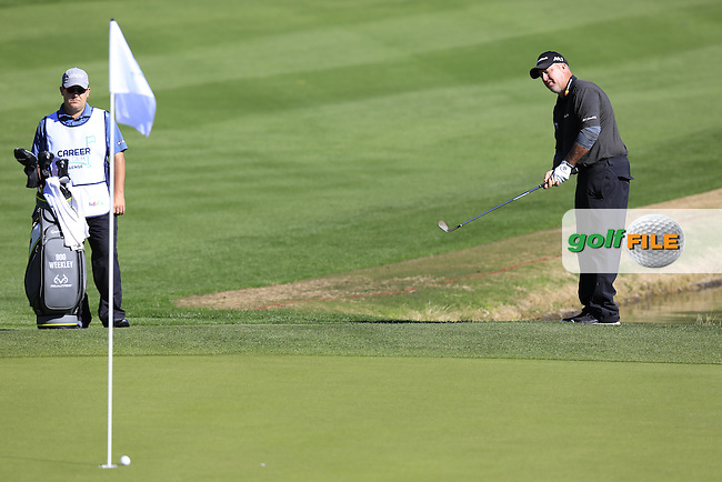 Boo Weekley (USA) chips onto the 9th green during Saturday's Round 3 of the 2017 CareerBuilder Challenge held at PGA West, La Quinta, Palm Springs, California, USA.<br /> 21st January 2017.<br /> Picture: Eoin Clarke | Golffile<br /> <br /> <br /> All photos usage must carry mandatory copyright credit (&copy; Golffile | Eoin Clarke)