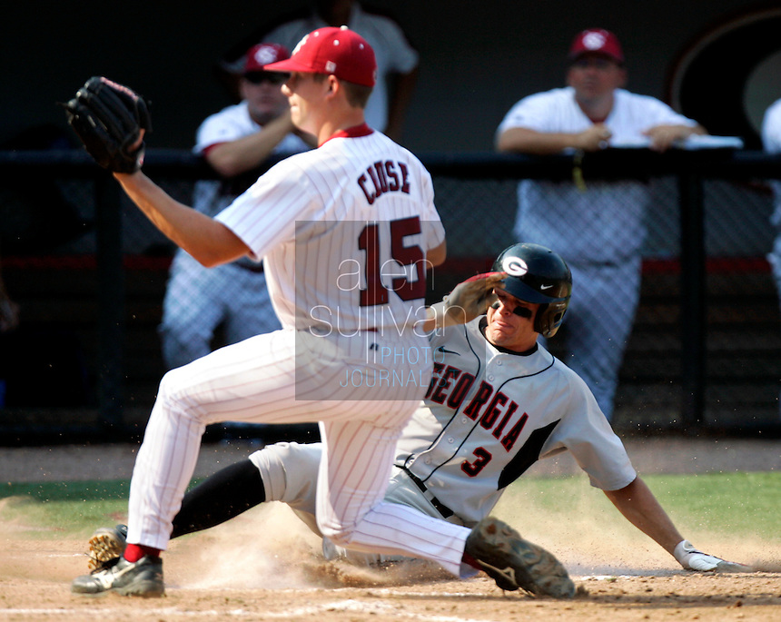 Georgia's Ryan Peisel (3) scores on a wild pitch from South Carolina's Andrew Cruse (15) in the third inning in Game 2 of the NCAA Athens Super Regional on Sunday, June 11, 2006, bringing Georgia into the lead at 5-4. Georgia won the game 11-5.