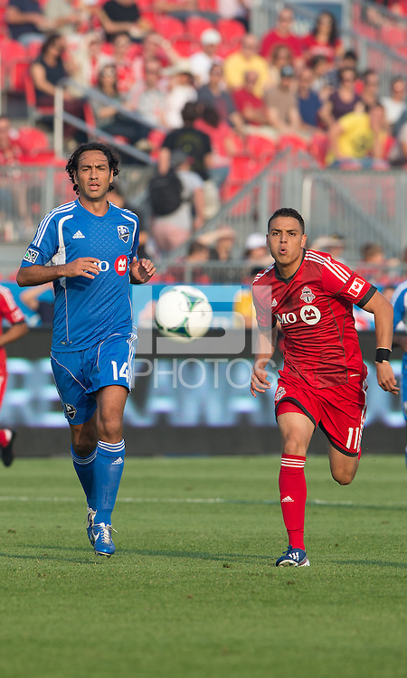 July 3, 2013: Montreal Impact defender Alessandro Nesta #14 and Toronto FC midfielder Luis Silva #11in action during an MLS game between Toronto FC and Montreal Impact at BMO Field in Toronto, Ontario Canada.<br /> The game ended in a 3-3 draw.