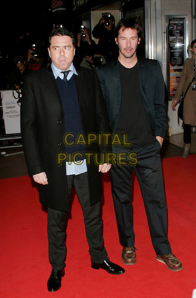 "SACHA GERVASI & KEANU REEVES .at the premiere of ""Anvil! The Story Of Anvil"" during the Times BFI 52nd London Film Festival, at the Odeon West End, London, England, .October 21, 2008..full length grey gray scarf black navy suit black coat tie jumper brown shoes .CAP/AH.©Adam Houghton/Capital Pictures"