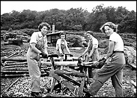 BNPS.co.uk (01202 558833)<br /> Pic:   HistoryPress/BNPS<br /> <br /> Stripping pit props - From left to right : Myra Turley, Gwen Murral, Kitty Byett and Edith Robothan.<br /> <br /> These inspiring photos tell the little known story of the patriotic women who chopped down trees to help us win the Second World War.<br /> <br /> When war was declared in September 1939 Britain was almost completely dependent on imported timber and only had seven months worth of it stockpiled.<br /> <br /> With men being sent to the front line in their droves, the Woman's Timber Corps was established to fell trees, operate sawmills and run forestry sites.<br /> <br /> About 15,000 women, some as young as 14, volunteered to carry out the arduous tasks previously done by men.
