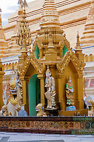 Myanmar, Burma.  Shwedagon Pagoda, Yangon, Rangoon.  Shrine honoring nats, Buddhist spirits worshiped in Myanmar.