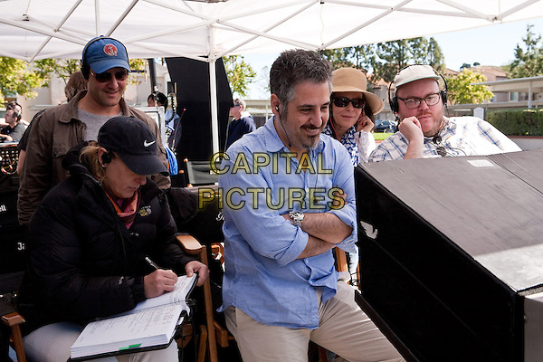 (L-r) Writer DAN FOGELMAN (rear), director GLENN FICARRA, producer DENISE DI NOVI and director JOHN REQUA.on the set of Crazy, Stupid, Love. .*Filmstill - Editorial Use Only*.CAP/FB.Supplied by Capital Pictures.
