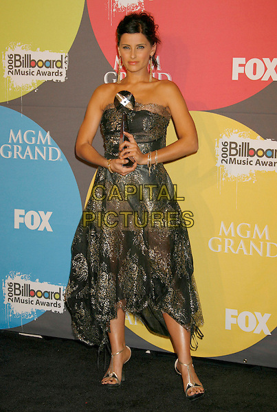 NELLY FURTADO.2006 Billboard Music Awards held at the MGM Grand Hotel and Casino, Las Vegas, Nevada, USA..December 4th, 2006.full length black grey gray gold strapless dress award trophy.CAP/ADM/RE.©Russ Elliot/AdMedia/Capital Pictures