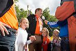 Engeland, London, 29 juli 2012.Olympische Spelen London.Mariaane Vos van Oranje wint de gouden Medaille bij de wegwedstrijd op de Olympische spelen en wordt gefeliciteerd door de kroon Prins Willem Alexander en Maxima die daarna werden geïnterviewd