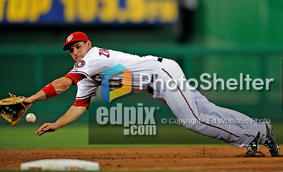 16 August 2008: Washington Nationals' third baseman Ryan Zimmerman is unable to reach a line drive by Garrett Atkins in the third inning against the Colorado Rockies at Nationals Park in Washington, DC.  The Rockies defeated the Nationals 13-6, handing the last place Nationals their 9th consecutive loss. ..Mandatory Photo Credit: Ed Wolfstein Photo