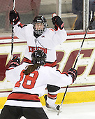 Lori Antflick (NU - 77), Siena Falino (NU - 18) - The Harvard University Crimson defeated the Northeastern University Huskies 4-3 (SO) in the opening round of the Beanpot on Tuesday, February 8, 2011, at Conte Forum in Chestnut Hill, Massachusetts.