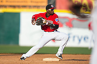 Hickory Crawdads second baseman Travis Demeritte (25) attempts to turn a double play against the Greensboro Grasshoppers at L.P. Frans Stadium on May 6, 2015 in Hickory, North Carolina.  The Crawdads defeated the Grasshoppers 1-0.  (Brian Westerholt/Four Seam Images)