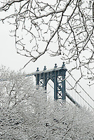 The Manhattan Bridge Viewed Thru Snow Covered Trees in Lower Manhattan, New York City , New York State, USA