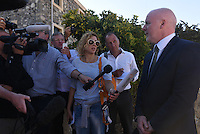 "Pictured: Detective Inspector Jon Cousins of South Yorkshire Police (R) speaks to the media after a search in a field in Kos, Greece. Wednesday 28 September 2016<br /> Re: Police teams searching for missing toddler Ben Needham on the Greek island of Kos have said they are ""optimistic"" about new excavation work.<br /> Ben, from Sheffield, was 21 months old when he disappeared on 24 July 1991 during a family holiday.<br /> Digging has begun at a new site after a fresh line of inquiry suggested he could have been crushed by a digger.<br /> South Yorkshire Police (SYP) said it continued to keep an ""open mind"" about what happened to Ben."