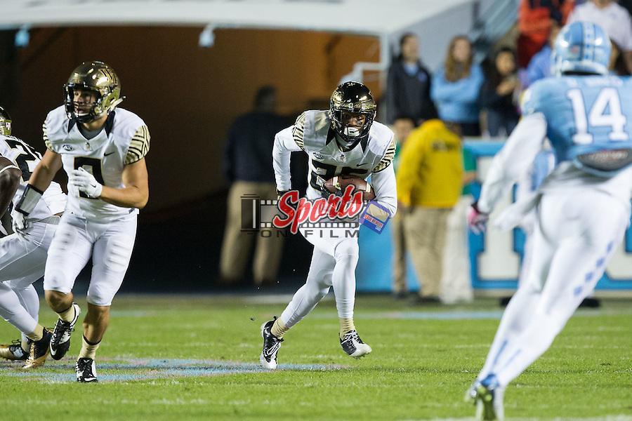 Brad Watson (25) of the Wake Forest Demon Deacons returns a first quarter interception against the North Carolina Tar Heels at Keenan Stadium on October 17, 2015 in Chapel Hill, North Carolina.   (Brian Westerholt/Sports On Film)