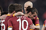 Calcio, Serie A: Roma vs Milan. Roma, stadio Olimpico, 22 dicembre 2012..AS Roma forward Pablo Daniel Osvaldo, bottom right, celebrates with teammates after scoring during the Italian Serie A football match between AS Roma and AC Milan at Rome's Olympic stadium, 22 December 2012.UPDATE IMAGES PRESS/Riccardo De Luca