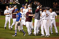 Kevin Medrano (13) of the Missouri State Bears is surrounded after hitting the game winning hit during a game against the Kansas Jayhawks at Hammons Field on March 27, 2012 in Springfield, Missouri. (David Welker/Four Seam Images)