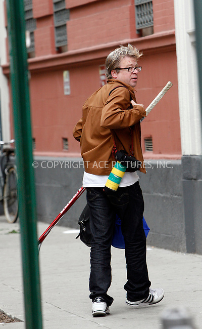 WWW.ACEPIXS.COM . . . . .  ....May 23 2010, New York City....Actor Mike Myers was seen walking in the Greenwich Village area with two friends, all carrying hockey sticks on May 23 2010 in New York City.....Allegedly Mike Myers decided that he didn't want to be photographed by the few photographers who had spotted him, and started running away. At that point his two friends allegedly attacked one of the photographers, stealing his camera and hitting him sharply on the head with a hockey stick, causing a wound which began to bleed. Another photographer interveened, and the Police were called. They arrested the two friends of Myers.....Please byline: NANCY RIVERA- ACEPIXS.COM.... *** ***..Ace Pictures, Inc:  ..Tel: 646 769 0430..e-mail: info@acepixs.com..web: http://www.acepixs.com