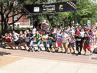 """Incoming students participated in the tradition of """"Crossing the Tracks"""" as they became Boilermakers during Boiler Gold Rush. Just a few short years later and they will cross the same tracks as they leave as a Purdue alumni!"""