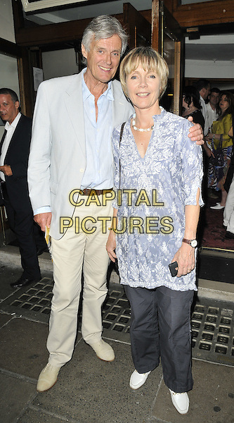"SIMON WILLIAMS & LUCY FLEMMING .At ""The Secret of Sherlock Holmes"" Press Night, Duchess Theatre, London, England, UK, July 20th 2010..full length blue shirt jacket beige trousers jeans dress tunic print .CAP/CAN.©Can Nguyen/Capital Pictures."
