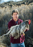 President of Whiting Farms Thomas Whiting in Delta, Colorado, Wednesday, March 16, 2016. Whiting, who holds a Ph.D. in poultry genetics, raises roosters for their feathers which he sells on the international market, mostly for making fly fishing lures. <br /> <br /> Photo by Matt Nager